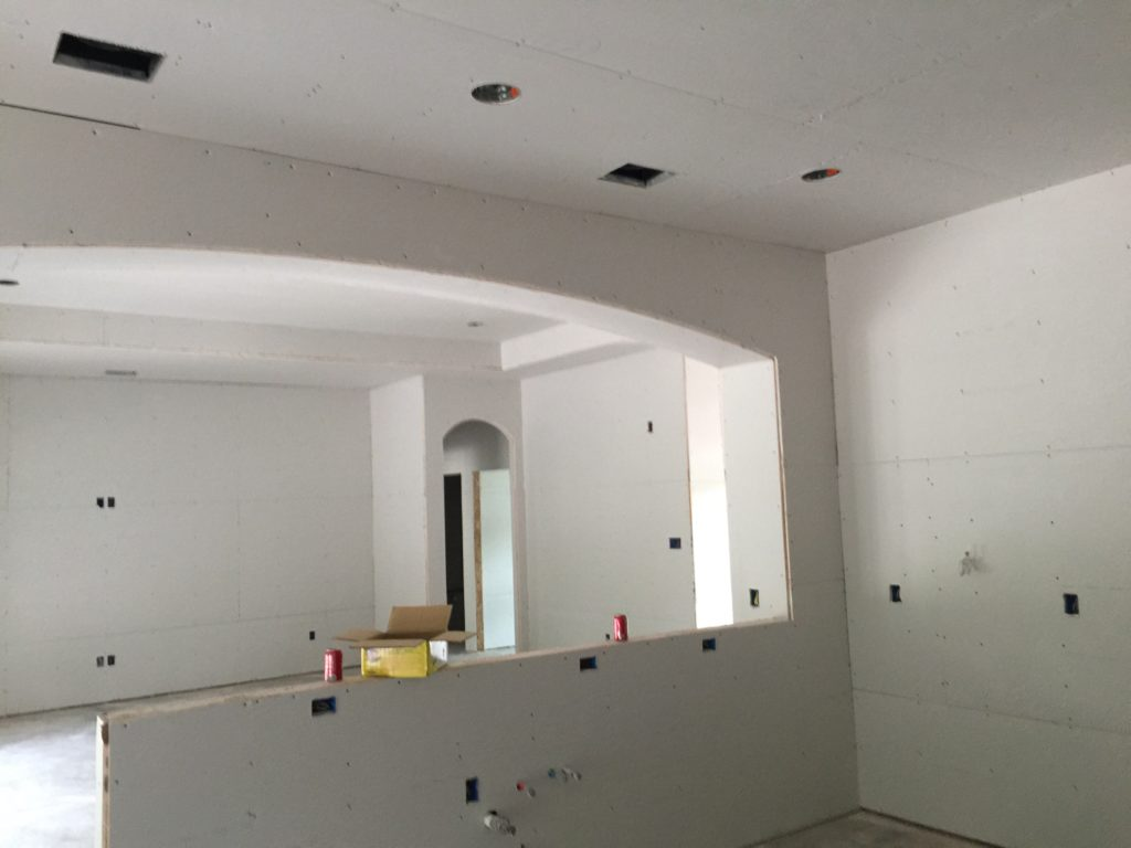 Sheetrock is Hung from Kitchen to Living